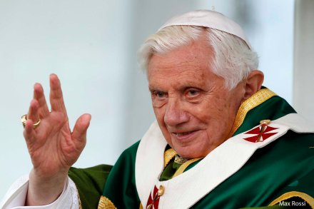 Pope Benedict XVI waves as he leads the Sunday mass during his one day pastoral visit to the Italian southern city of Lamezia Terme